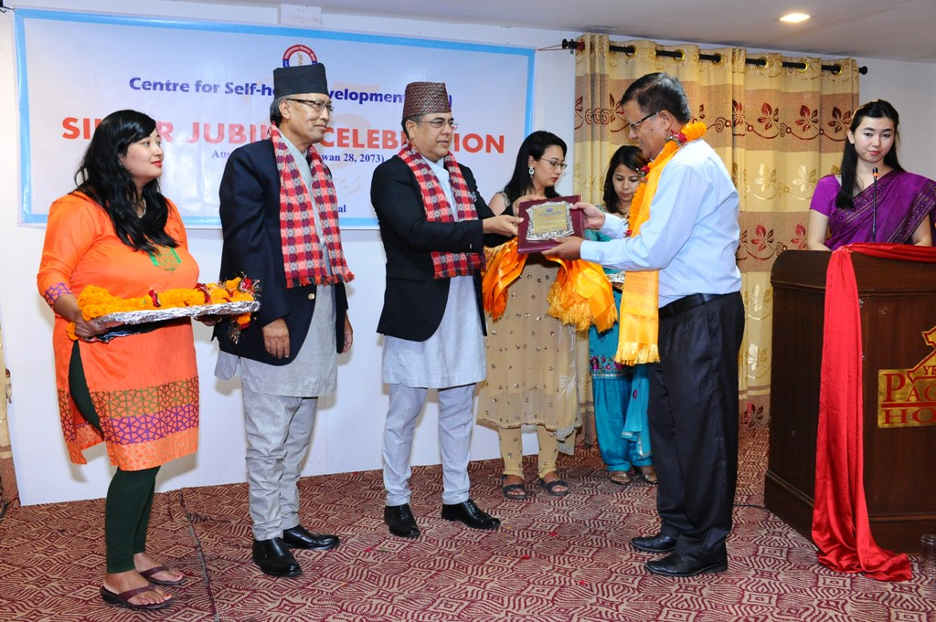 Cheif Guest felicitating Mr. Rajendra Pradhan, Executive Director - SOLVE Nepal