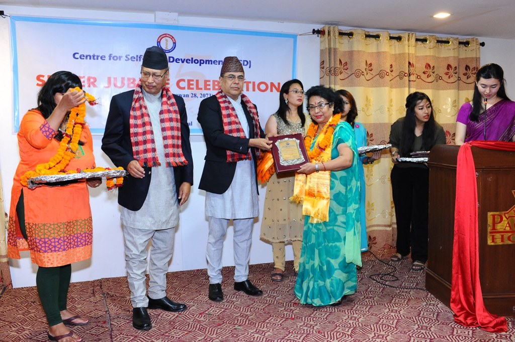 Cheif Guest felicitating Ms. Anila Shrestha, Executive Chairperson - Women Support Cooperative