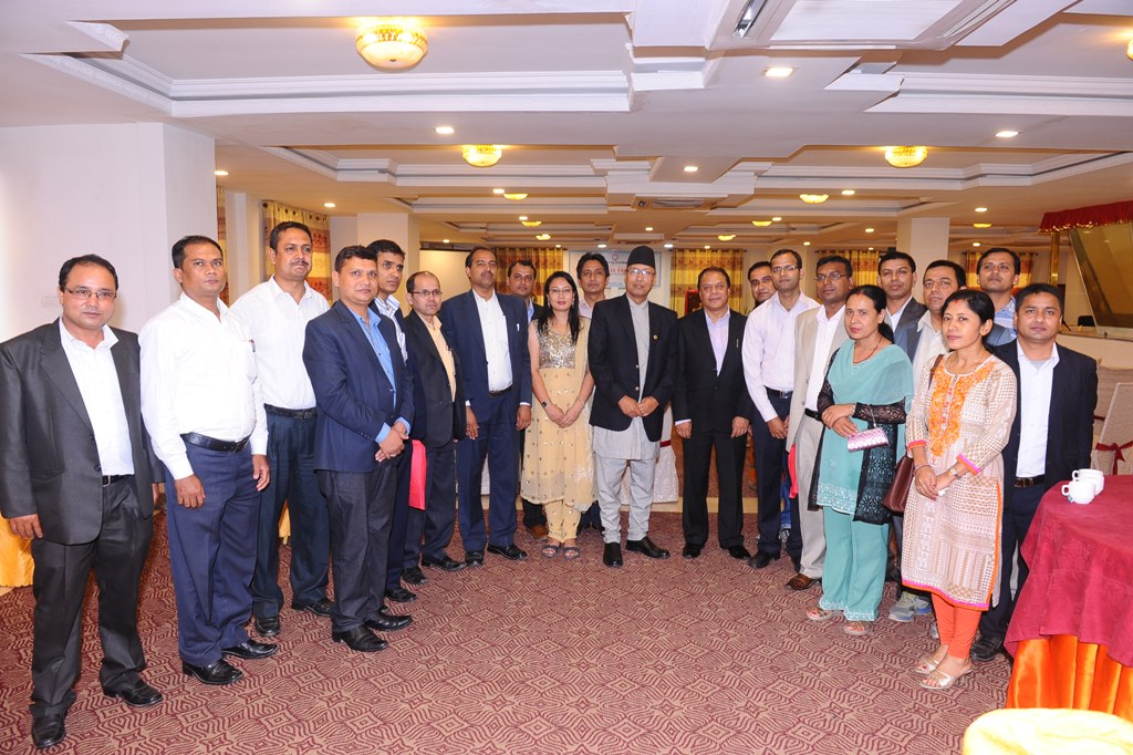 Mr. Shankar Man Shrestha, Chairman - CSD posing for a Group Picture with the former employees of CSD